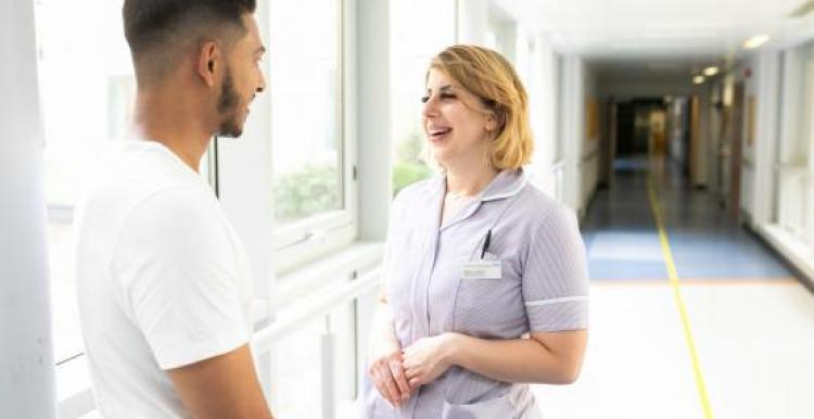 Young man talking to nurse in a hospital setting