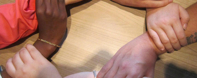 Hands interlinking