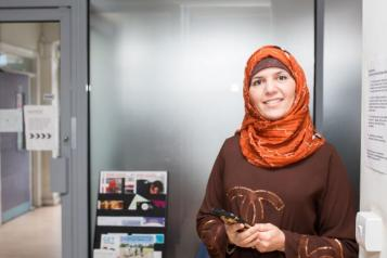 Woman in a meeting room smiling at the camera