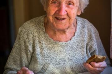Elderly lady eating