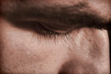 Close up of mans face looking down