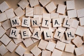 Mental health spelled out in wooden blocks