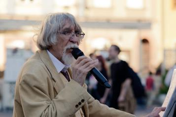 Older man with microphone singing