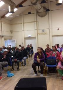 The Nepalese Association of Wiltshire sitting in a large hall