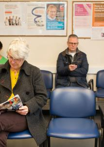 Picture of people sitting in a waiting room in a medical setting