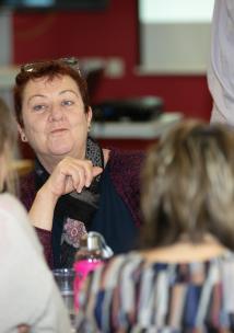 Woman talking at a meeting