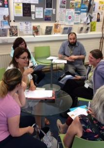 Photo of volunteers from Swindon Advocacy Movement with learning disabilities having a planning meeting for Enter and View Visits